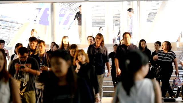 Crowd of people walking in downtown