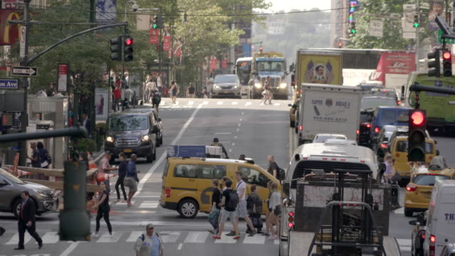 crowd of people walking in the city. pedestrians crossing busy street. urban metropolis lifestyle background