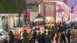 crowd of people walking Myeong-dong night market at  Seoul ,South Korea