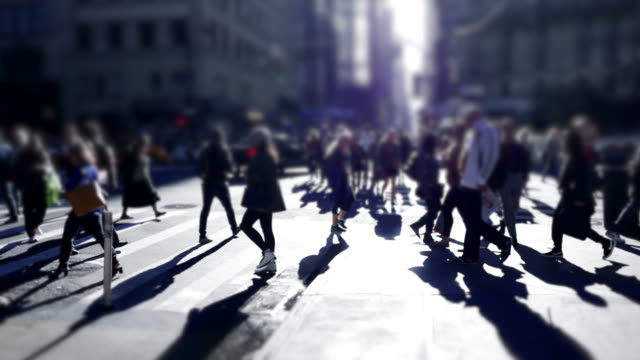 crowd of people walking on city street. commuting to work background