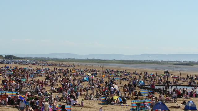 crowd of people watching event on beach - weston super mare stock videos and b-roll footage