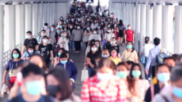 crowd of people wear face mask for protect corovavirus or covid-19 outbreak. - prevention stock videos & royalty-free footage
