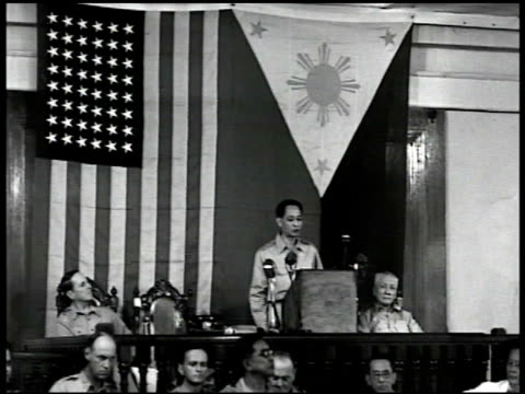 stockvideo's en b-roll-footage met crowd of philippine officials at gate cu sign 'philippines house of representatives' int philippine president manuel roxas introducing gen douglas... - 1946