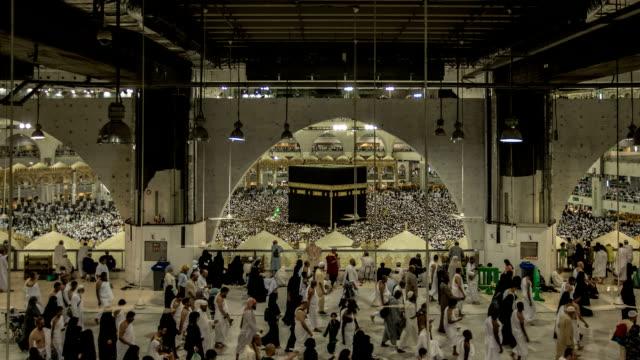 crowd of pilgrims circumambulate around kaaba - hajj stock videos & royalty-free footage