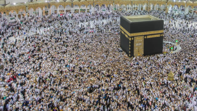 crowd of pilgrims circumambulate around kaaba - ring stock videos and b-roll footage
