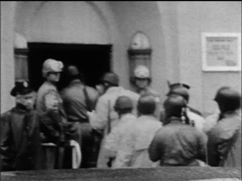 view crowd of policemen in riot gear entering attica state prison during riot / ny - prison riot stock videos & royalty-free footage