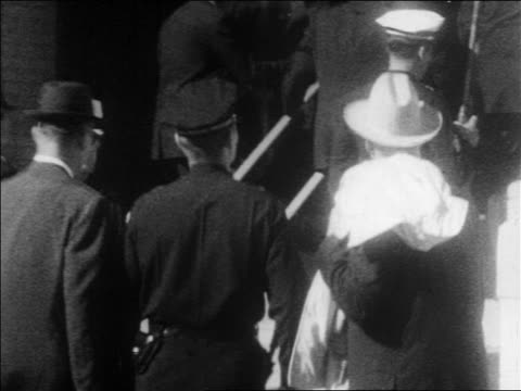 crowd of policemen walking up stairs entering building / kennedy assassination - assassination of john f. kennedy stock videos & royalty-free footage