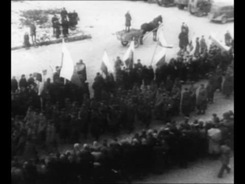 crowd of polish citizens watches at right foreground as soviet troops march through a ruined square in warsaw as they arrive in the city during world... - warsaw stock videos & royalty-free footage
