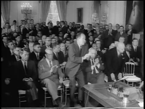 b/w 1964 crowd of politicians clapping standing up / johnson signing civil rights act - generalstaatsanwalt stock-videos und b-roll-filmmaterial