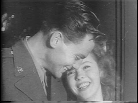 crowd of press flash camera lights on shirley temple and sergeant john agar after wedding ceremony, they pose for press, are greeted by guests /... - celebrities video stock e b–roll