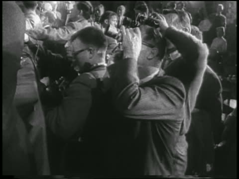 b/w 1958 crowd of reporters photographers at press conference for first us satellite / newsreel - 1958 stock videos & royalty-free footage