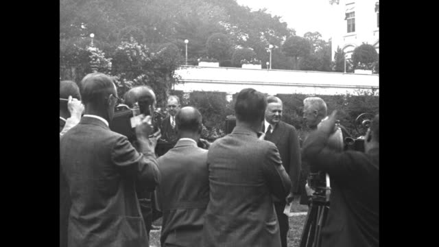 crowd of reporters with film and movie cameras around president herbert hoover and hugo eckener, commander of the graf zeppelin, as they stand... - circumnavigation stock videos & royalty-free footage