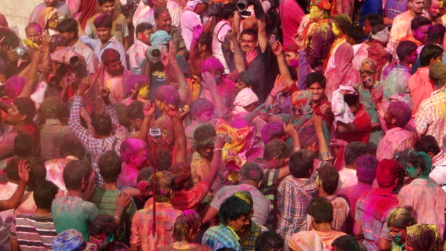 A crowd of revellers dancing to the music at Holi, festival of colours
