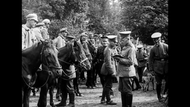 crowd of russian soldiers are disarmed by german soldiers / line of russian cavalry sitting on horses are disarmed by german soldiers / german... - cavalry stock videos & royalty-free footage