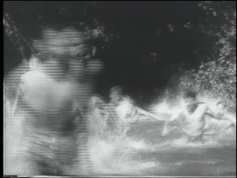 b/w 1943 crowd of shirtless men running in lake toward + past camera / us navy cadets - shirtless stock videos & royalty-free footage