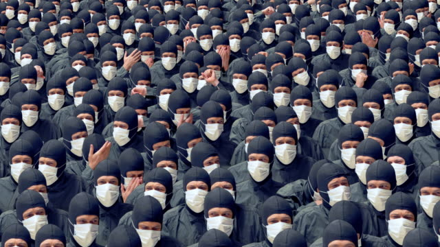 a crowd of sick people in medical masks coughing and sneezing. - climate change stock videos & royalty-free footage