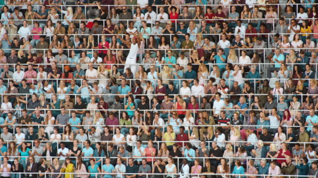 ld crowd of spectators at the stadium clapping their hands to the rhythm - standing out from the crowd stock videos & royalty-free footage