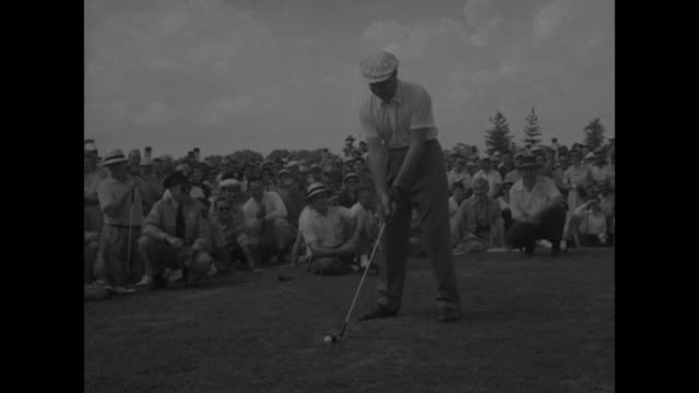 vídeos de stock e filmes b-roll de crowd of spectators on woodmont country club golf course some watch with periscopes / gen omar bradley making shot spectators behind him / us vice... - bob hope comediante