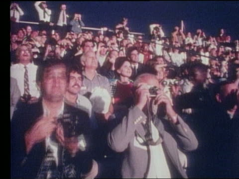 crowd of spectators with cameras for atlantis shuttle launch - 1985年点の映像素材/bロール