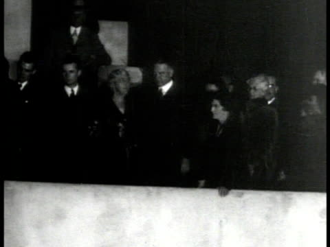 Crowd of Stanford University students singing WS Wife Lou H Hoover President Herbert Hoover on balcony HA WS Students singing WS Hoover waving from...