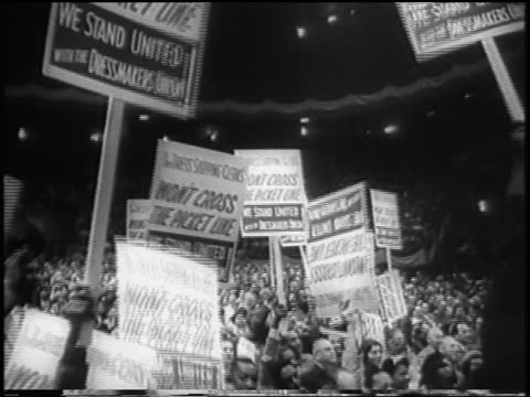 b/w 1958 crowd of striking garment workers with signs in madison square garden rally nyc / newsreel - fackförbund bildbanksvideor och videomaterial från bakom kulisserna