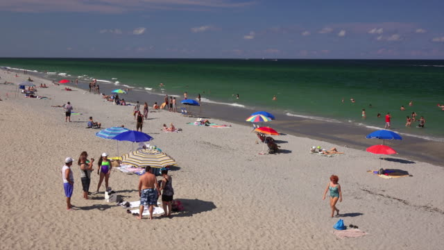 Crowd of sunbathers at South Beach Pavilion Park in Boca Raton, Florida