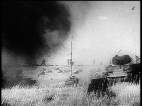 vídeos de stock e filmes b-roll de pan crowd of tanks moving over countryside amidst explosions during world war ii - 1944