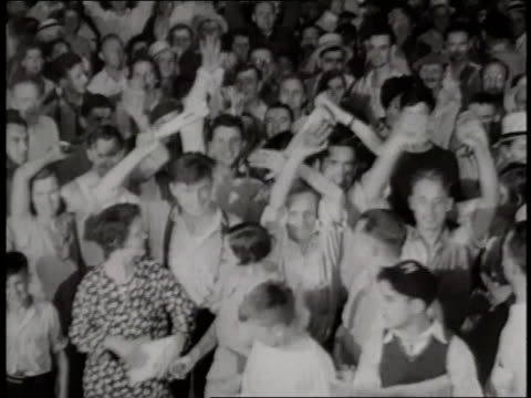 a crowd of teenagers cheer and wave holding a newspaper stating dillinger slain' - john dillinger stock-videos und b-roll-filmmaterial