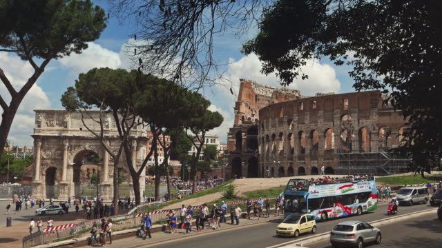 Crowd of tourists by the Coliseum of Rome