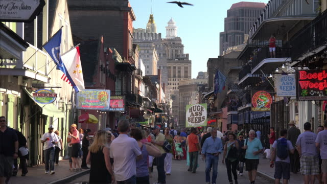 Crowd of tourists fill Bourbon Street during the day in the French Quarter of New Orleans, Louisiana