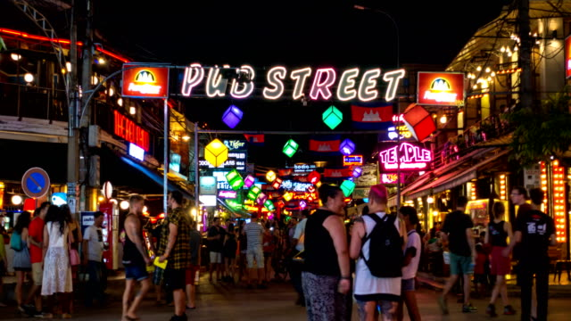 crowd of tourists walking along in pub street, siem reap, cambodia - angkor stock videos and b-roll footage