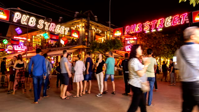 crowd of tourists walking along in pub street, siem reap, cambodia - cambodia stock videos & royalty-free footage
