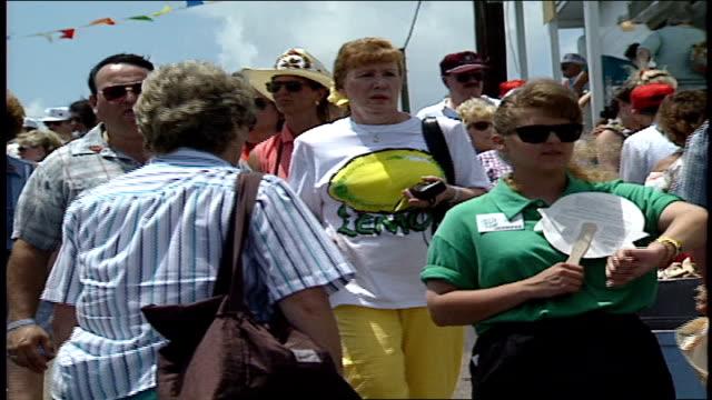 crowd of tourists walking at country music fan fair in nashville, tn - お祭り好き点の映像素材/bロール
