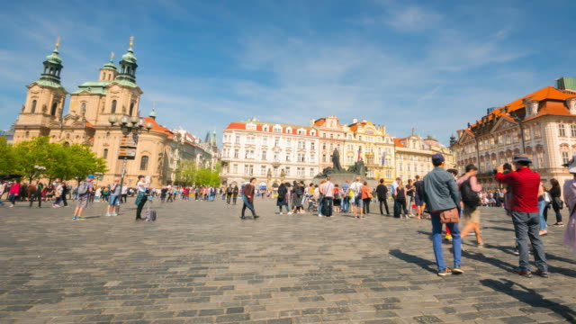 crowd of tourists wolking in prague old town square at sunny day - prague old town square stock videos & royalty-free footage