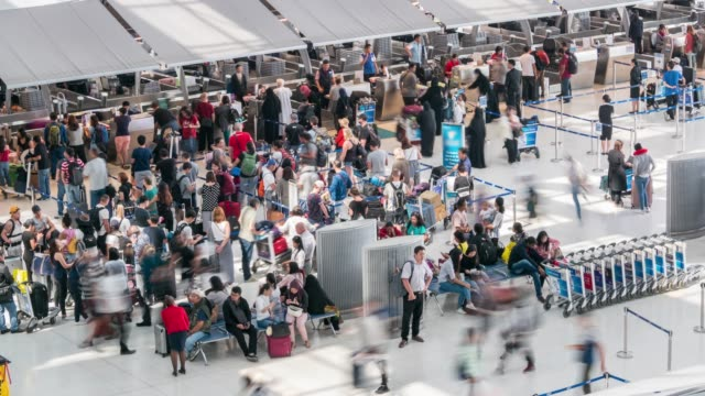 crowd of traveler tourist at airport departure area