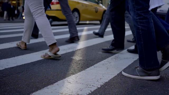 crowd of unrecognizable people walking in the city. pedestrians crossing street. urban metropolis background