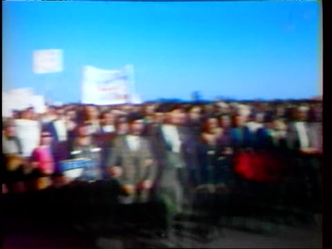vidéos et rushes de crowd of war veterans with banners and american flag marching in antivietnam war peace demonstration / crowd carrying returned volunteers signs war... - 1967