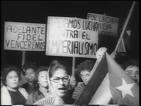 b/w 1962 crowd of women carrying posters in demonstration at night / cuban missile crisis / newsreel - cuban missile crisis stock videos & royalty-free footage
