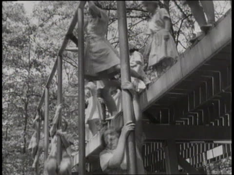 a crowd of women runs through an obstacle course as training for their service in the armed forces - womens army corps stock videos & royalty-free footage