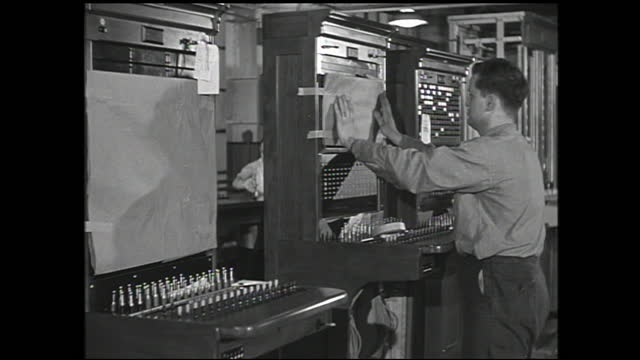 crowd of workers entering western electric factory; workers working on the assembly line and operating various machines - 1940 1949 stock videos & royalty-free footage