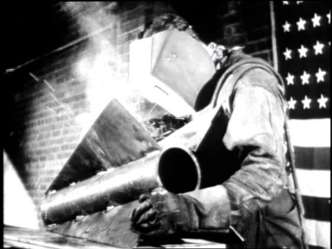 crowd of workers leaving factory / men working on tanks on assembly line / welder / two factory workers / man at work/ woman working with hacksaw /... - 金属工業点の映像素材/bロール