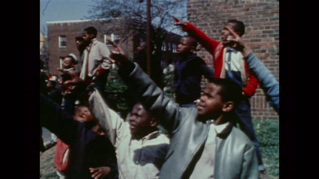 crowd of young boys point at the flames and smoke of a nearby building fire - 1968 stock videos & royalty-free footage