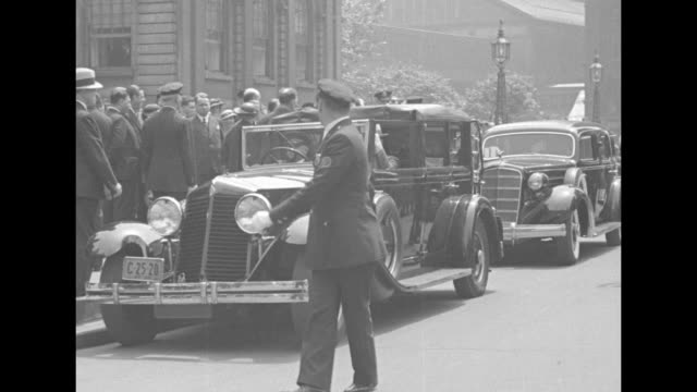 crowd on sidewalk police on street and limo parked at curb at new york city hall in background ny mayor fiorello la guardia stands on sidewalk near... - fiorello la guardia stock videos & royalty-free footage