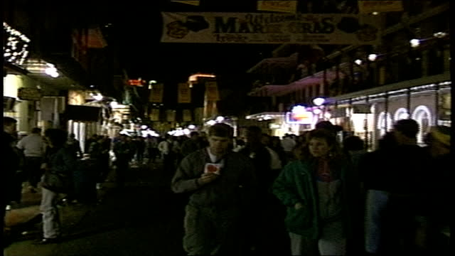 crowd on street in night during mardi gras in new orleans - gras stock videos and b-roll footage