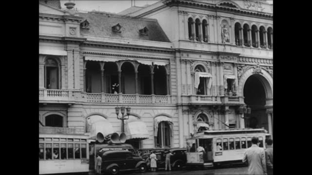 Crowd on street outside Casa Rosada Buenos Aires MS Male assistant President Pedro Ramirez at desk amp Colonel Juan Peron in office MS Ramirez...
