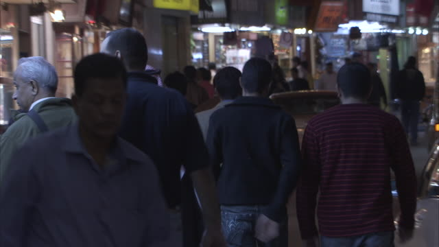 ms crowd on street some people shopping at night / manamba ,bahrain - persian gulf stock videos & royalty-free footage