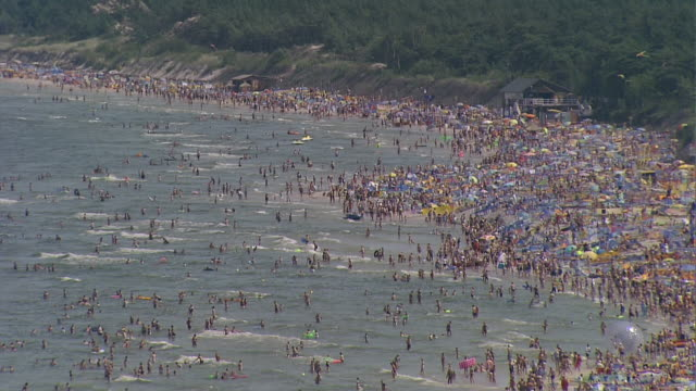 crowd on the beach in leba (polish city). people on the beach and in the water. - poland stock videos & royalty-free footage