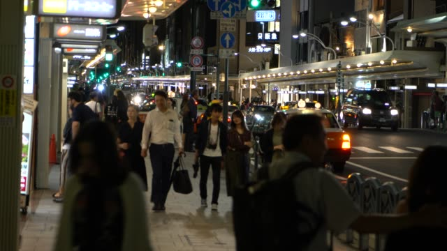 crowd on the shijo street by night - gion stock videos and b-roll footage
