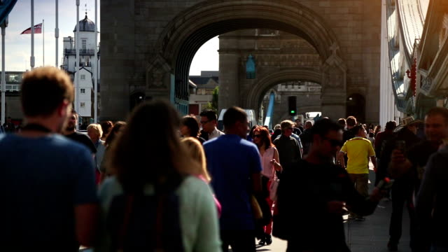 crowd on the tower bridge in london, england - bascule bridge stock videos and b-roll footage