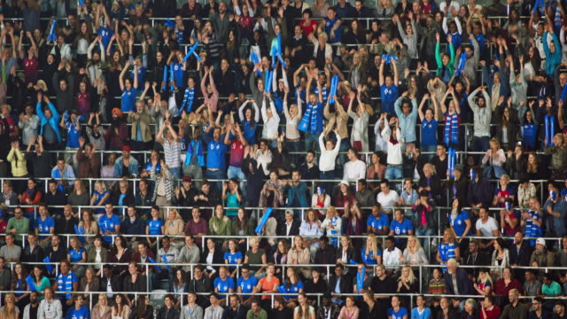 stockvideo's en b-roll-footage met ld crowd on the tribune at a sports event doing the mexican wave - viering